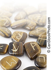 Rune Stones carved in Tiger's Eye - Close up of Rune Stones...