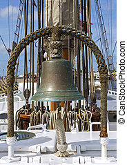 Old ship deck with copper bell