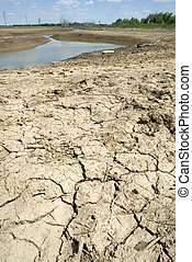 Drought - Cracked the ground on a background of the dried up...