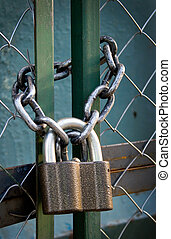padlock suspended by two chains