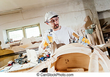 Carpenter working at a wood table