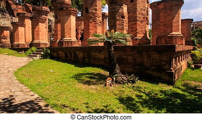 view of old pillars at ruins of culture centre Tháp Bà...