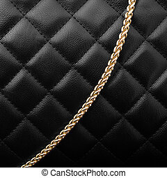 Black leather with golden chain