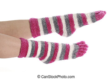 feet with pink toe socks isolated on white background
