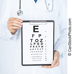male ophthalmologist with eye chart - healthcare, medicine...