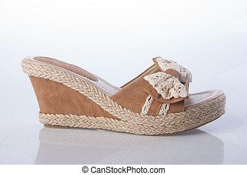 sandal  - female fashion sandal on Background