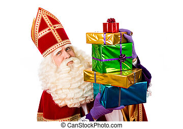 Sinterklaas showing gifts - sinterklaas with gifts . typical...