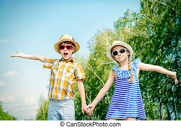friends - Portrait of happy kids on a bright sunny day....