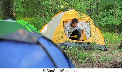 Tent in the woods europe man stopped for the night in...