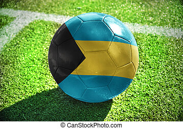 football ball with the national flag of bahamas lies on the...