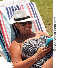 On vacation - A mature woman wearing sunglasses while on...