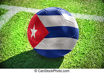 football ball with the national flag of cuba lies on the...