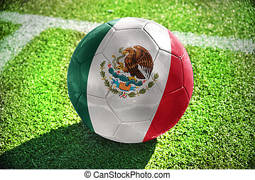 football ball with the national flag of mexico lies on the...