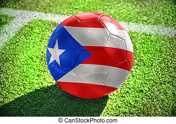 football ball with the national flag of puerto rico lies on...