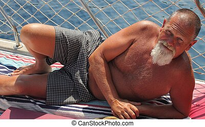 An englishman with a beard while on vacation during the...