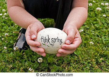 Spring Egg - Young child holding a goose egg.