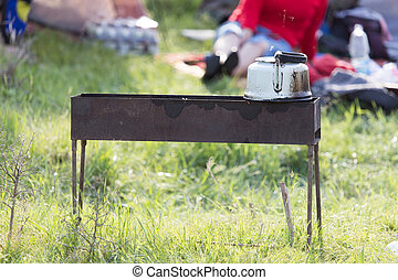Kettle on the grill in nature