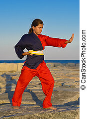 Self Defense - Beautiful girl practicing self defense on...