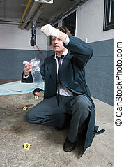 Bagging evidence - Police inspector bagging a side arm as...