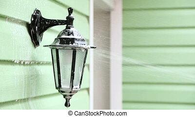 Jet Of Water Washing Foam Off Street Lamp