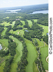 Aerial view of lakes area golf course showing several holes