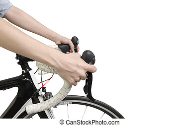 Closeup on woman hands riding a bike, isolated on white...