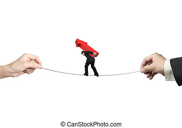 Businessman carrying arrow sign balancing tightrope with hands holding
