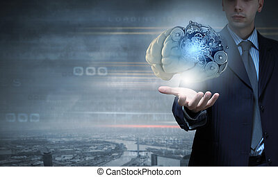 Process of thinking - Close up of businessman holding human...