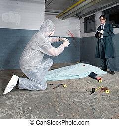 Crime Scene Investigation - Forensic expert bagging evidence...