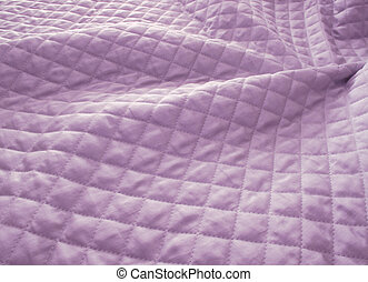 Quilted purple fabric - Close up view of a purple quilt in...