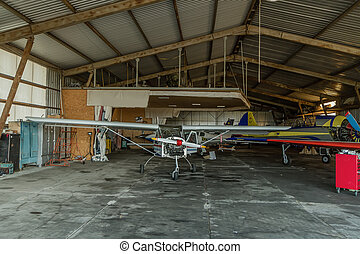 shattered Airplane in hangar