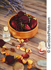 Rose tincture - Close-up of dry rose petals and essence
