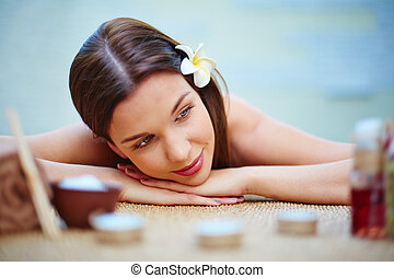 Bliss - Young woman relaxing at spa salon