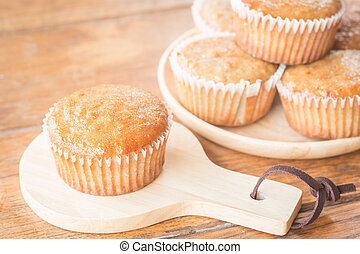 Homemade banana muffins on wooden plate, stock photo