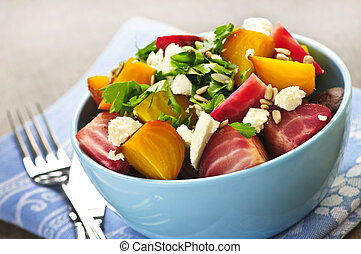 Roasted red and golden beets - Bowl of roasted sliced red...