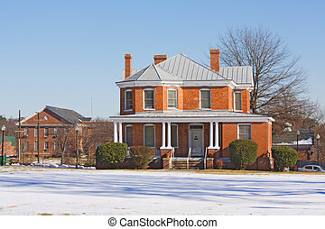 Storum Hall on the campus of Virginia State University near Petersburg, Virginia, one of the public, Historically Black Colleges and Universities (HBCUs) with blue sky and white snow in winter