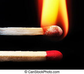 Wooden matches. - Two wooden matches.