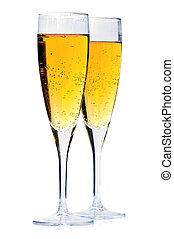 Champagne glasses - Two full champagne flutes isolated on...