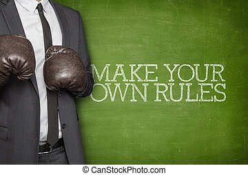 Make your own rules on blackboard with businessman on side -...