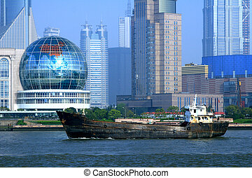 Shanghai Shipping - View of modern Shanghai with the an old...