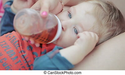 Baby with bottle in countryside - Nature baby boy in mothers...