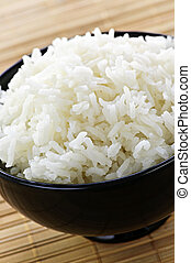 Rice bowl - White steamed rice in black round bowl