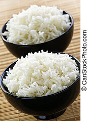 Rice bowls - White steamed rice in two black round bowls