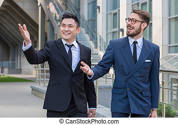 Portrait of multi ethnic business teamThe two smiling men...