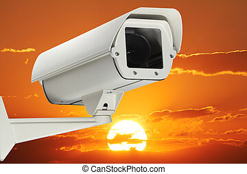 security - A new security Camera with sunset as background.