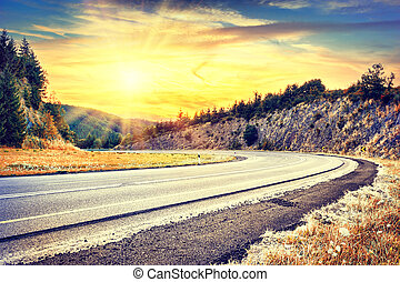 Beautiful autumn landscape with curvy road Travel concept