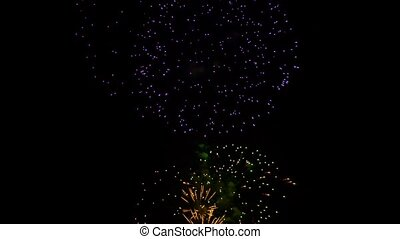 Multicolored Fireworks Sparkling At Holiday Night Sky - This...