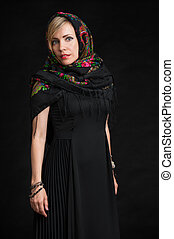 beautiful woman wearing Russian headscarf - portrait of a...