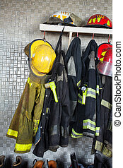 Firefighter Equipment Arranged At Fire Station - Firefighter...