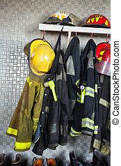 Firefighter Equipment Arranged At Fire Station - Firefighter...
